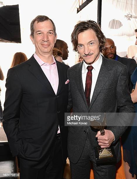 CEO of Piaget Philippe LeopoldMetzger and actor John Hawkes pose in the Piaget Lounge during The 2013 Film Independent Spirit Awards on February 23...