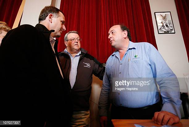 Of Pike River Coal Peter Whittall talks to New Zealand Prime Minister John Key while Minister of Energy and Resources Gerry Brownlee looks on at...