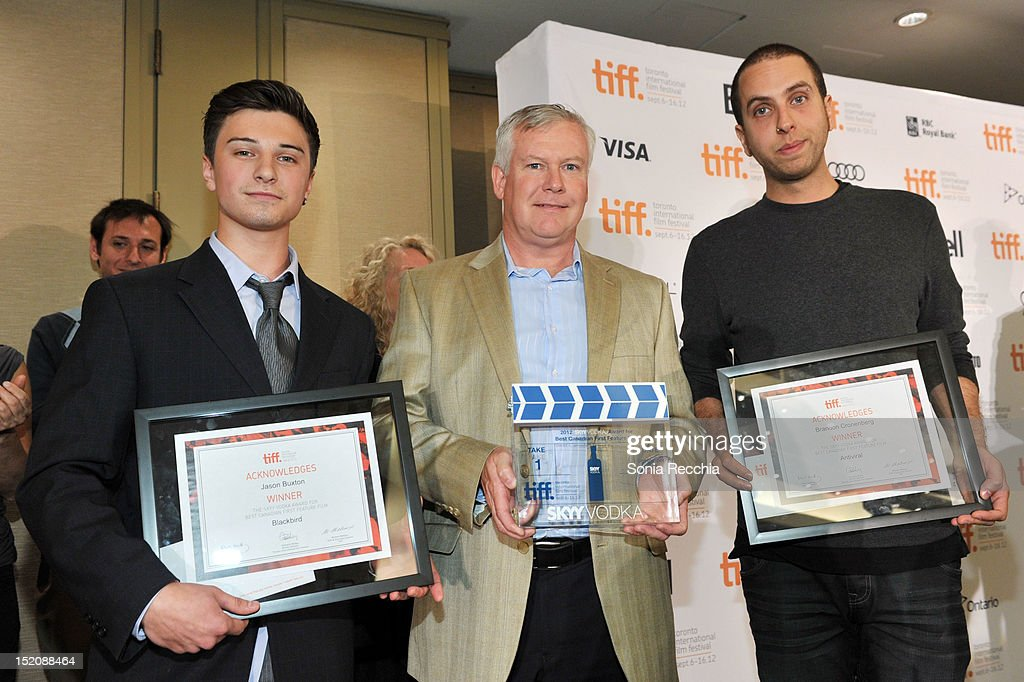 CMO of PMARob Malloch (C) poses with the winners of The SKYY Vodka Award for Best Canadian First Feature Film, actor Alex Ozerov (accepting on behalf of filmmaker Jason Buxton) (L) for 'Blackbird' and Brandon Cronenberg for'Antiviral' attend the 37th Toronto International Film Festival Award Winner Ceremony held at the InterContinental Toronto Center Hotel on September 16, 2012 in Toronto, Canada.
