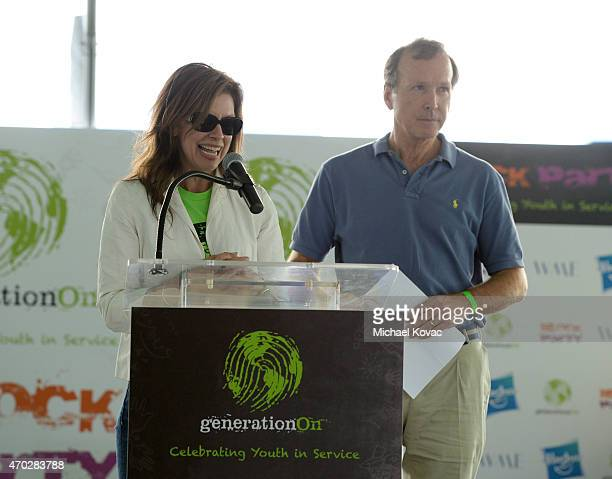 CEO of Points of Light Tracy Hoover and Chairman of the Board of Points of Light Neil Bush speak at the Points of Light generationOn Block Party on...