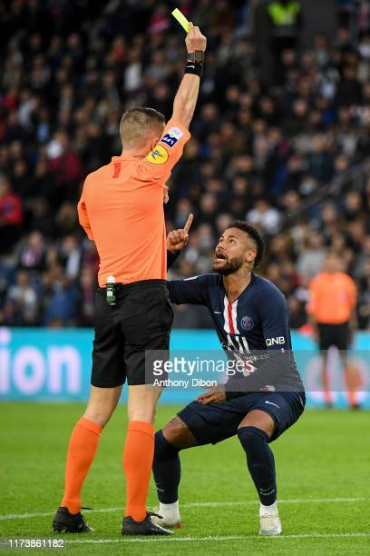 JR of PSG receives a yellow card from referee Willy DELAJOD during the Ligue 1 match between Paris SaintGermain and Angers SCO at Parc des Princes on...