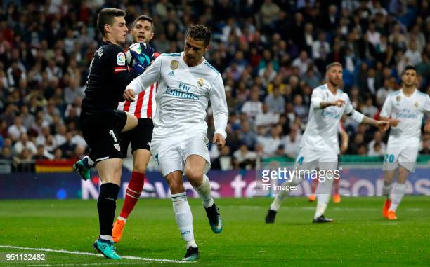 of Real Madrid and Kepa of Athletic Club battle for the ball during the La Liga match between Real Madrid and Athletic Club at Estadio Santiago...