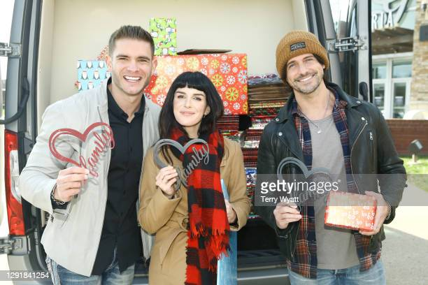 Of Redline Steel Colin Wayne, actress Shenae Grimes and Singer-songwriter Jesse Labelle attend the Redline Steel Holiday Give-Back at Pottery Barn on...