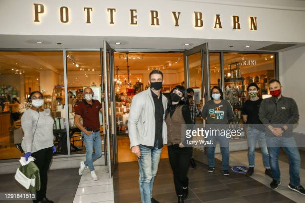 Of Redline Steel Colin Wayne and actress Shenae Grimes along with the staff of Pottery Barn during the Redline Steel Holiday Give-Back at Pottery...