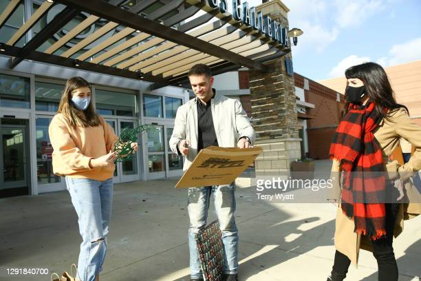 Of Redline Steel Colin Wayne and actress Shenae Grimes hand out free gifts during the Redline Steel Holiday Give-Back at Pottery Barn on December 17,...