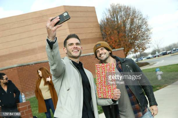 Of Redline Steel Colin Wayne and Singer-songwriter Jesse Labelle attend the Redline Steel Holiday Give-Back at Pottery Barn on December 17, 2020 in...
