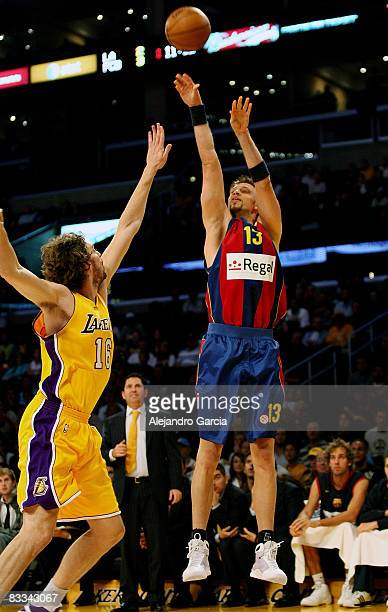 of Regal FC Barcelona David Andersen and of Los angeles Lakers Pau Gasol in action during the Euroleague Basketball American Tour match between Los...