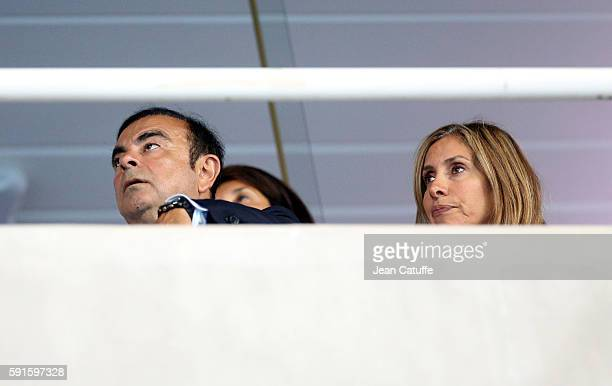CEO of Renault and Nissan Carlos Ghosn and his wife Carole Ghosn attend the athletics competition on day 11 of the Rio 2016 Olympic Games at Olympic...