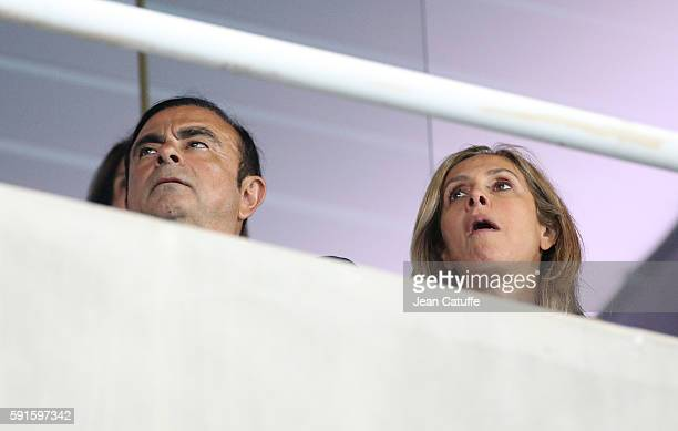 CEO of Renault and Nissan Carlos Ghosn and his wife Rita Ghosn attend the athletics competition on day 11 of the Rio 2016 Olympic Games at Olympic...