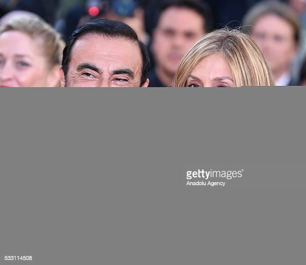 CEO of Renault Carlos Ghosn and his wife Carole arrive for the screening of the film 'The Last Face' at the 69th annual Cannes Film Festiva on May 20...