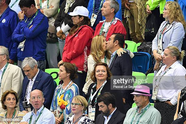 O of Renault Carlos Ghosn and his wife Carole Ghosn attend the Men's 4 x 100m Medley Relay Final on Day 8 of the Rio 2016 Olympic Games at the...