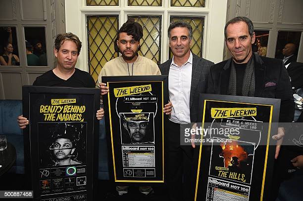 EVP of Republic Records Charlie Walk singer The Weeknd President/COO of Republic Records Avery Lipman and CEO of Republic Records Monte Lipman attend...