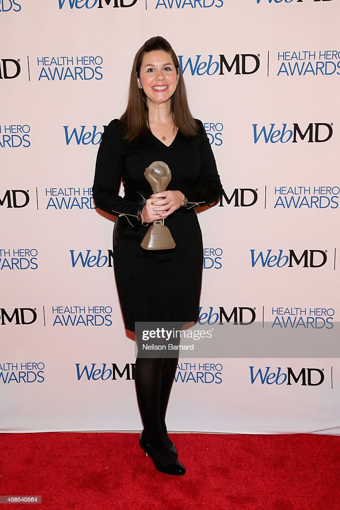 VP of Research Engagement at the Michael J. Fox Foundation Claire Meunier poses with an award backstage at the 2014 Health Hero Awards hosted by WebMD at Times Center on November 6, 2014 in New York City.