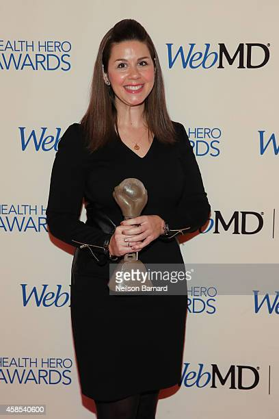 VP of Research Engagement at the Michael J Fox Foundation Claire Meunier poses with an award backstage at the 2014 Health Hero Awards hosted by WebMD...