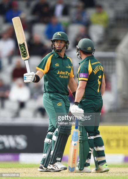 of Ross Taylor of Nottingham raises his bat after scoring 50 runs during Royal London OneDay Cup match between Lancashire and Nottinghamshire at Old...