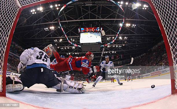 Of Russia and of Finland battle for the puck during the IIHF World Championship qualification match between Russia and Finland at Orange Arena on May...