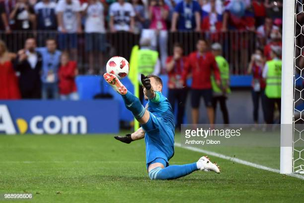 AKINFEEV of Russia stops the penalty of Iago Aspas of Spain during the FIFA World Cup Round of 26 match between Spain and Russia at Luzhniki Stadium...