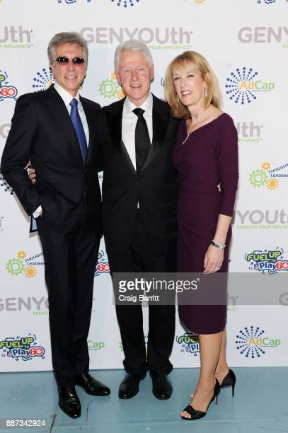CEO of SAP Bill McDermott former US President Bill Clinton and Julie McDermott attend the Second Annual GENYOUth Gala at Intrepid SeaAirSpace Museum...