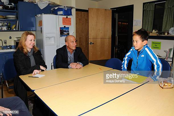 VP/GMM of Sears Apparel Julie Cashion and Sears Executive Vice President John Goodman tour the Tenderloin School on November 22 2010 in San Francisco...