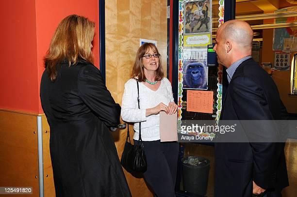 VP/GMM of Sears Apparel Julie Cashion Midge Wilson of the Bay Area Women's Center and Sears Executive Vice President John Goodman tour the Tenderloin...