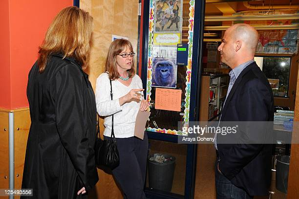 VP/GMM of Sears Apparel Julie Cashion Midge Wilson of the Bay Area Women's Center and Sears Executive Vice President John Goodman tour the Tenderloin...