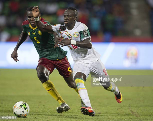 MANE of Senegal and NGADEU NGADJUI MICHAEL of Cameroon during the quarterfinal match between Senegal and Cameroon at Stade Franceville on January 28...