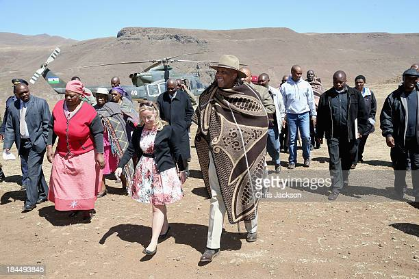 Of Sentebale Cathy Ferrier walks with his Majesty King Letsie III of Lesotho as he arrives for the opening ceremony of the new Sentebale Mateanong...