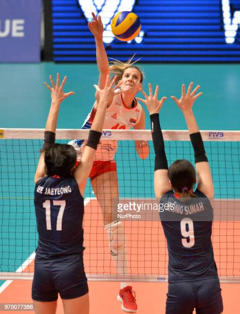 of Serbia in action against JAEYEONG LEE and SUNAH JEONG of Korea during FIVB Volleyball Nations League match between Korea and Serbia at the Stadium...