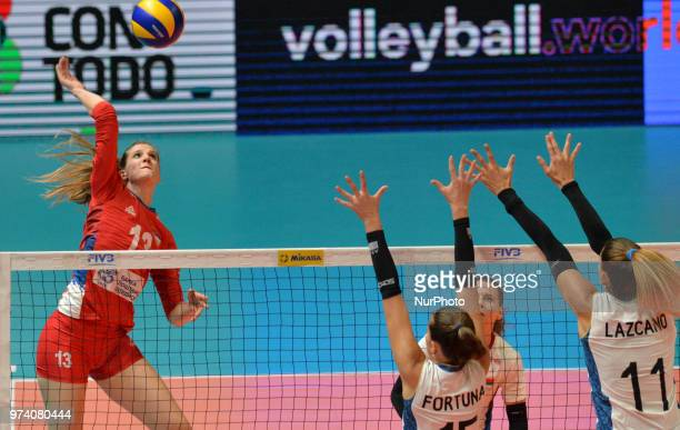 of Serbia in action against JULIETA CONSTANZA LAZCANO and ANTONELA FORTUNA of Argentina during FIVB Volleyball Nations League match between Argentina...