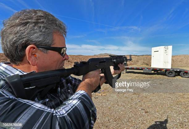 CEO of Shelter in Place Jim Haslem fires an AK47 assault rifle into one of his bullet resistant shelters on October 25 2018 in Cedar City Utah...