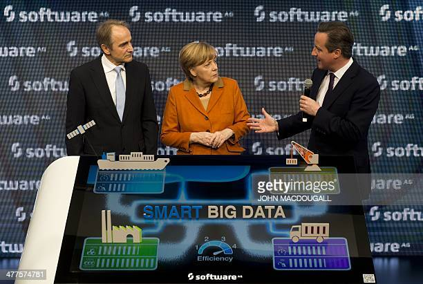 """Of Software AG Karl-Heinz Streibich, German Chancellor Angela Merkel and Britain's Prime Minister David Cameron chat during a presentation on """"Big..."""