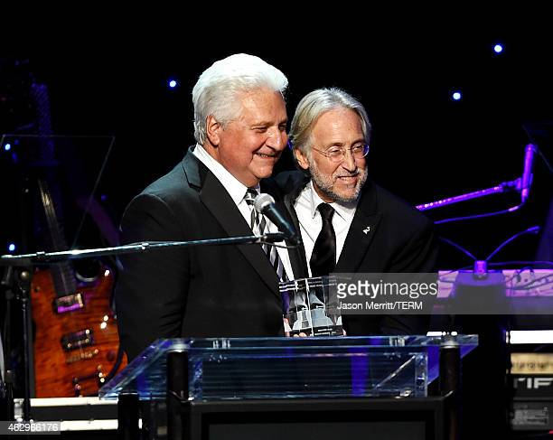 CEO of Sony/ATV Martin Bandier and President of the National Academy of Recording Arts and Sciences Neil Portnow speak onstage during the PreGRAMMY...