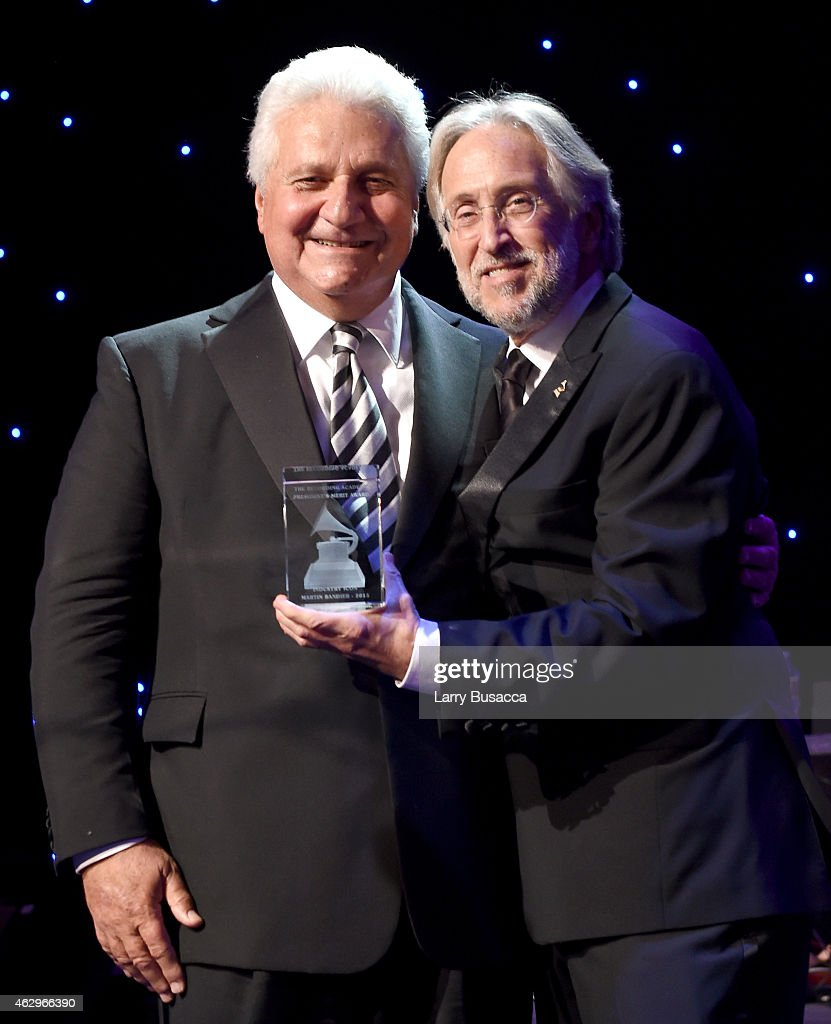 CEO of Sony/ATV Martin Bandier (L) and President of the National Academy of Recording Arts and Sciences, Neil Portnow speak onstage during the Pre-GRAMMY Gala and Salute To Industry Icons honoring Martin Bandier at The Beverly Hilton Hotel on February 7, 2015 in Beverly Hills, California.