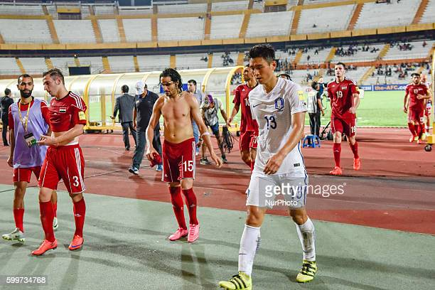of South Korea and Syria players finished the first half during the 2018 FIFA World Cup qualifying football match between South Korea and Syria at...