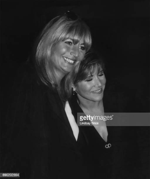 ACLU of Southern California Torch of Liberty Dinner 1995 Penny Marshall and Carrie Fisher lean onto one another both smiling Carrie's eyes closed at...
