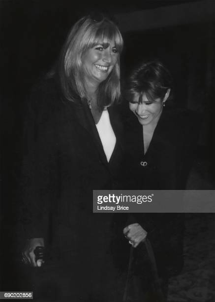 ACLU of Southern California Torch of Liberty Dinner 1995 Penny Marshall and Carrie Fisher lean toward another and laugh together at ACLU Torch of...