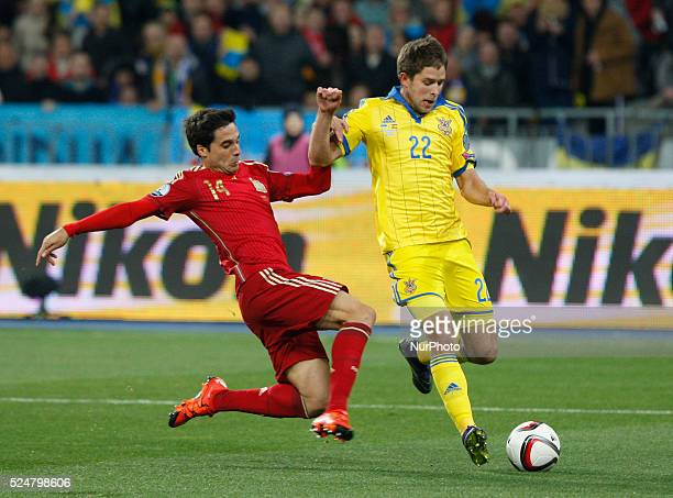 of Spanish national soccer team vies for the ball with ARTEM KRAVETS of Ukrainian national soccer team during the UEFA EURO 2016 qualifying group...