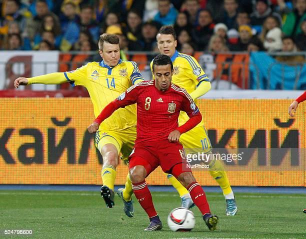 ALCANTARA of Spanish national soccer team vies for the ball with RUSLAN ROTAN and YEVHEN KONOPLYANKA of Ukrainian national soccer team during the...
