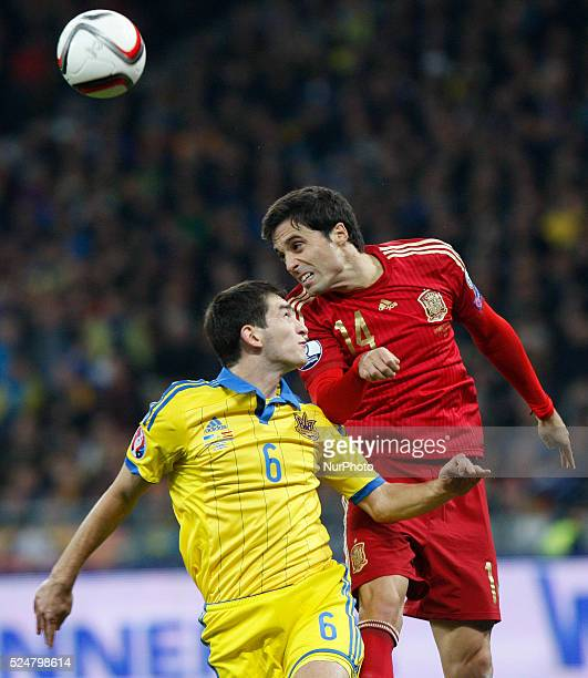 of Spanish national soccer team vies for the ball with TARAS STEPANENKO of Ukrainian national soccer team during the UEFA EURO 2016 qualifying group...