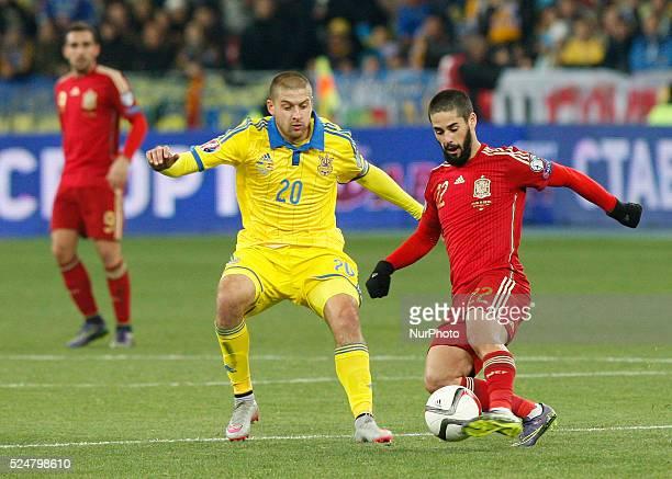 of Spanish national soccer team vies for the ball with YAROSLAV RAKITSKIY of Ukrainian national soccer team during the UEFA EURO 2016 qualifying...