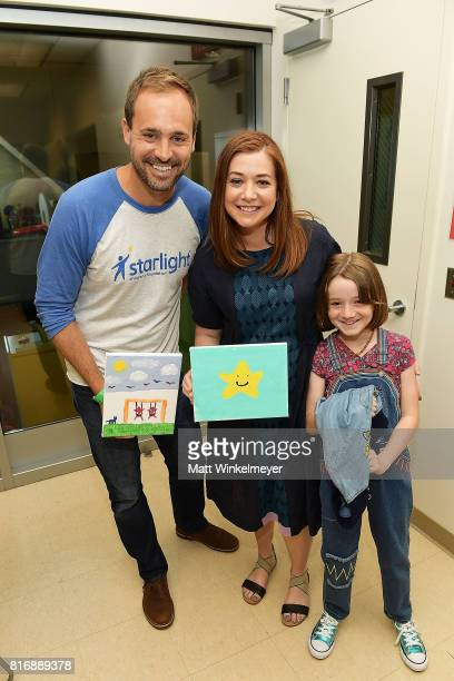 CEO of Starlight Children's Foundation Chris Helfrich Alyson Hannigan and Satyana Denisof pose for a photo as they visit kids with Starlight...