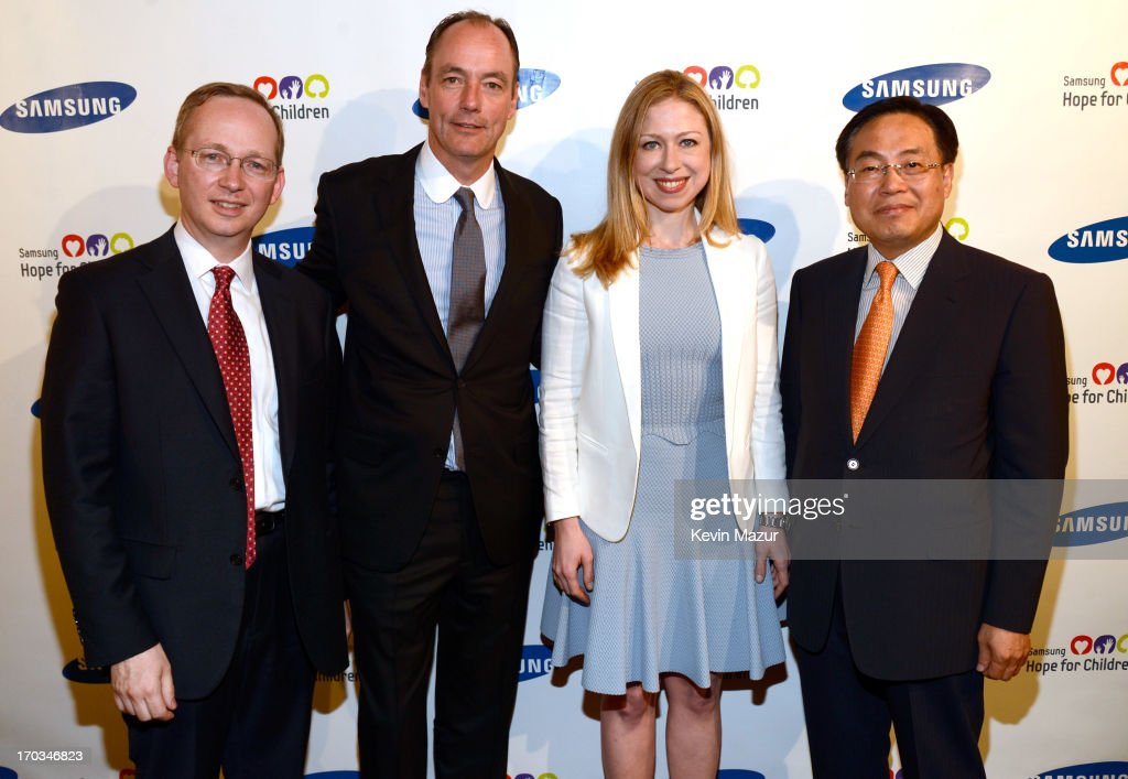 EVP of Strategy Samsung Electronics David Steel, President of Samsung Electronics America Tim Baxter, Chelsea Clinton and CEO of Samsung Electronics America YK Kim attend the Samsung's Annual Hope for Children Gala at CiprianiÕs in Wall Street on June 11, 2013 in New York City.