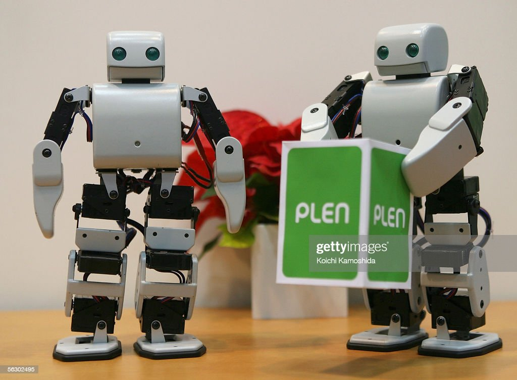 'PLEN' of System Akazawa lift up material during 2005 International Robot Exhibition on November 30, 2005 in Tokyo, Japan. PLEN can be controled by a mobile phone and is able to walk, stand on a feet, and sit down. The Exhibition is on until December 3.