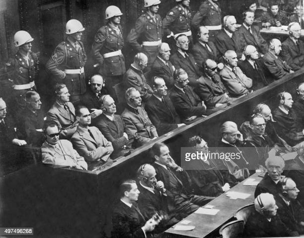 Of the 22 nazi leaders accused of war crimes during the world war II listen to the prosecution 01 October 1946 at the Nuremberg court. From L to R:...