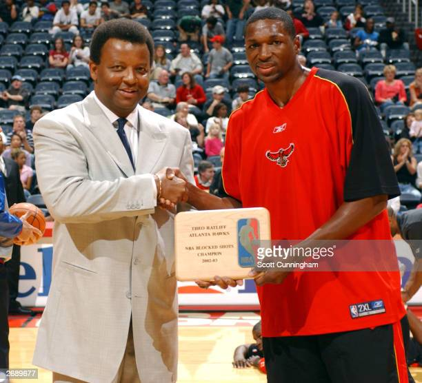GM of the Atlanta Hawks Billy Knight presents Theo Ratliff of the Hawks the 20022003 BLock Shot Leader Award prior the Hawks game against the Indiana...