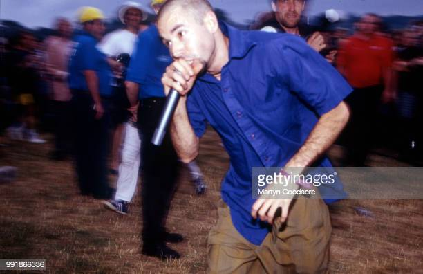 MCA of the Beastie Boys performs among the crowd at Glastonbury Festival 24th June 1994
