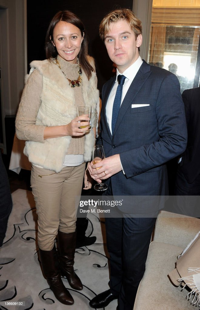 CEO of the British Fashion Council Caroline Rush (L) and actor Dan Stevens attend the Corinthia Artist In Residence winners announcement at Corinthia Hotel London on January 13, 2012 in London, England.