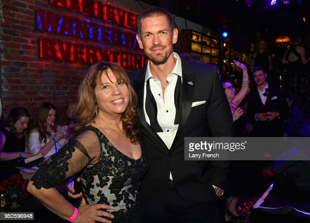 CEO of The Creative Coalition Robin Bronk and actor Steve Howey attend Playboy Presents No Tie Party at The Living Room on April 28 2018 in...