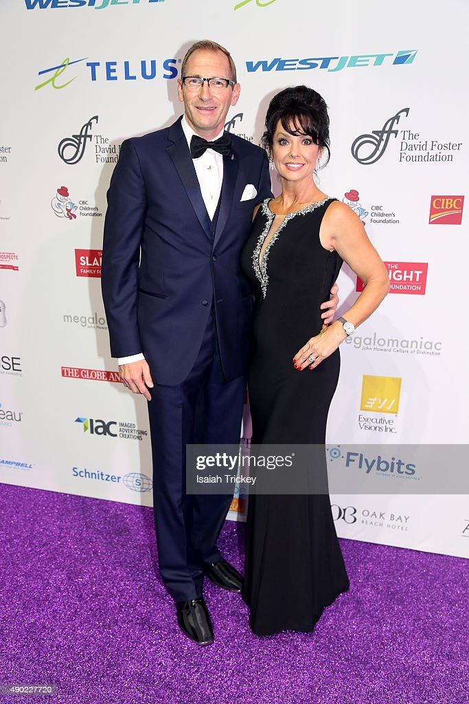 CEO of the David Foster Foundation, Michael Ravenhill and wife Cassandra Ravenhill arrive at the David Foster Foundation Miracle Gala And Concert at Mattamy Athletic Centre on September 26, 2015 in Toronto, Canada.