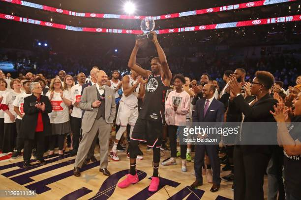 MVP of the game Kevin Durant of Team LeBron holds up his trophy after the 2019 NBA AllStar Game on February 17 2019 at the Spectrum Center in...